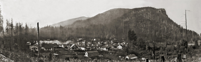 Then Caption: Darius Kinsey's ca. 1914 panorama of the King County town of Cedar Falls (aka Moncton) set beside the unstable shore of Rattlesnake Lake.