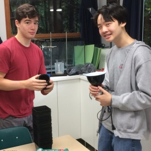 Students setting up light experiments